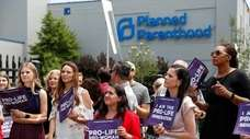 Anti-abortion advocates gather outside the Planned Parenthood clinic