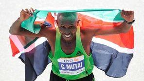 Geoffrey Mutai of Kenya celebrates after winning the