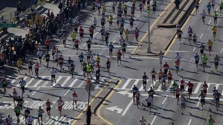 Runners jog through Park Slope in Brooklyn while