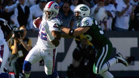 Fred Jackson of the Buffalo Bills runs against