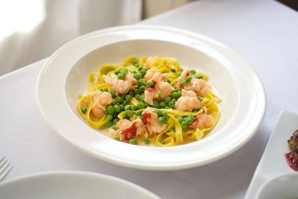 Hand-cut tagliatelle with lobster, peas and white butter