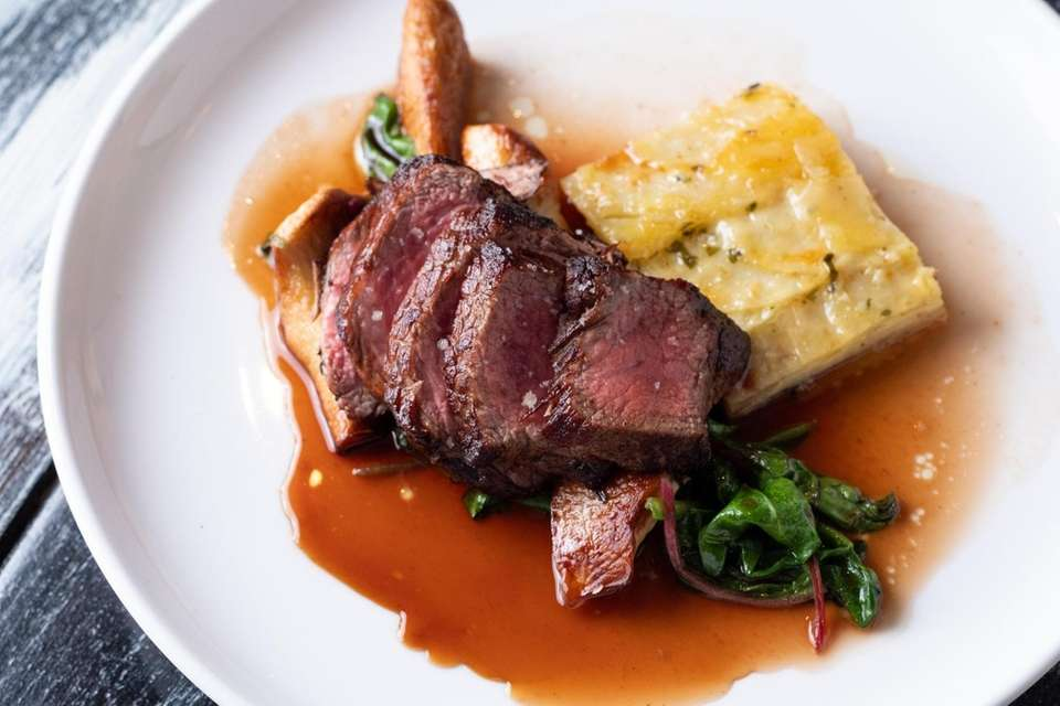 Beef striploin with garlic potato gratin, Swiss chard,
