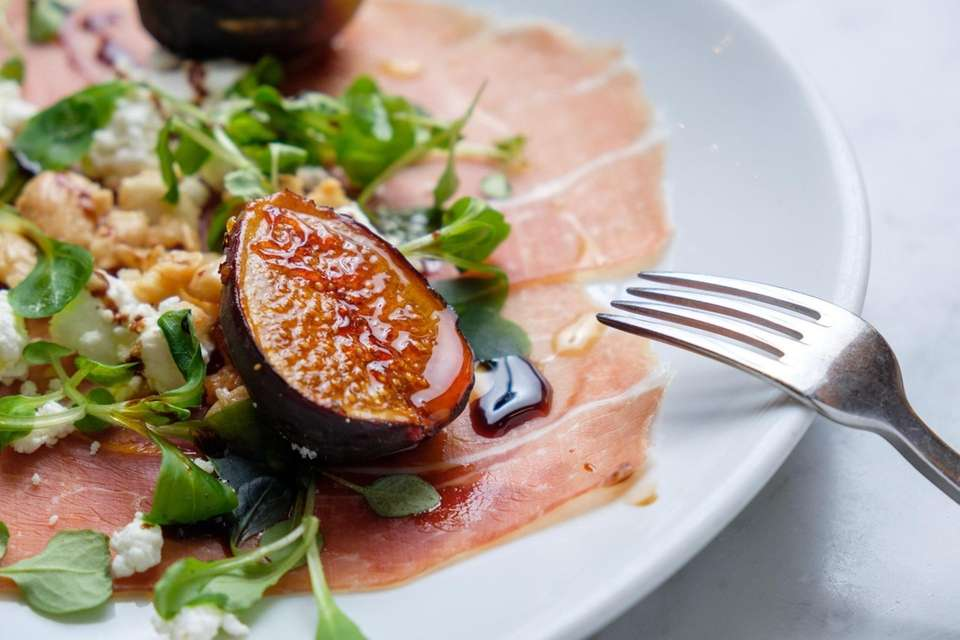 Caramelized figs with shaved prosciutto, almonds, goat cheese,