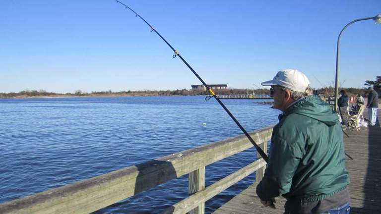A fisherman waits for at catch by a