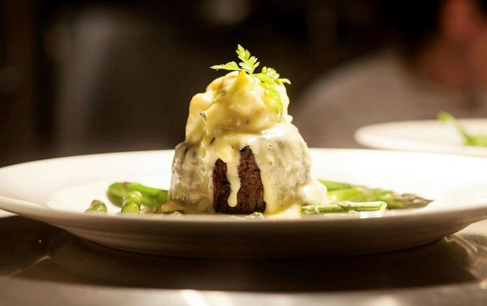 Filet Oscar, a filet mignon topped with crab