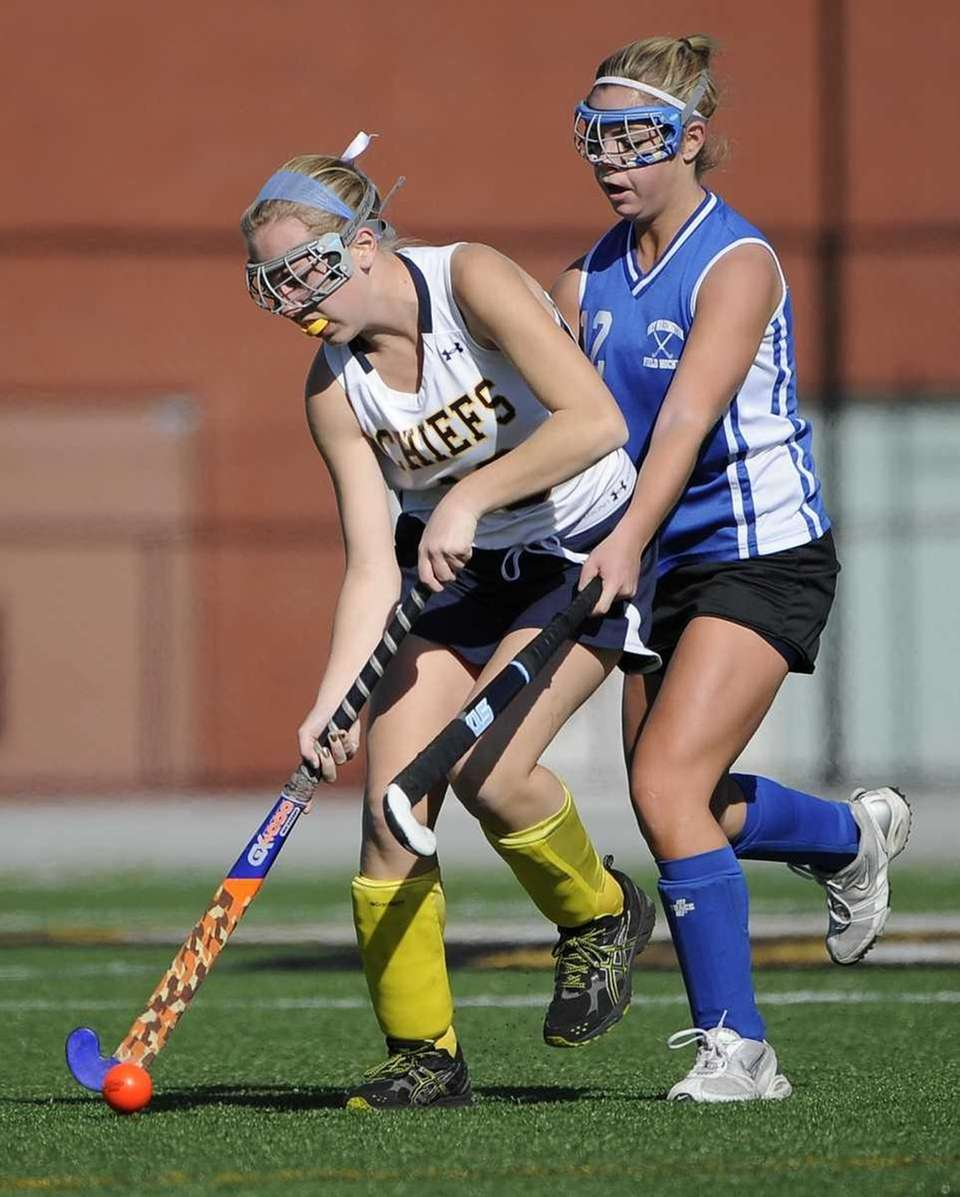 Massapequa's Dana Ahrens is pressured by Port Washington's