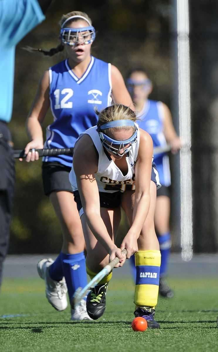 Massapequa's Nicole Scicutella plays the ball against Port