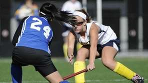 Massapequa's Jamie Ahrens defends against Port Washington's Alice