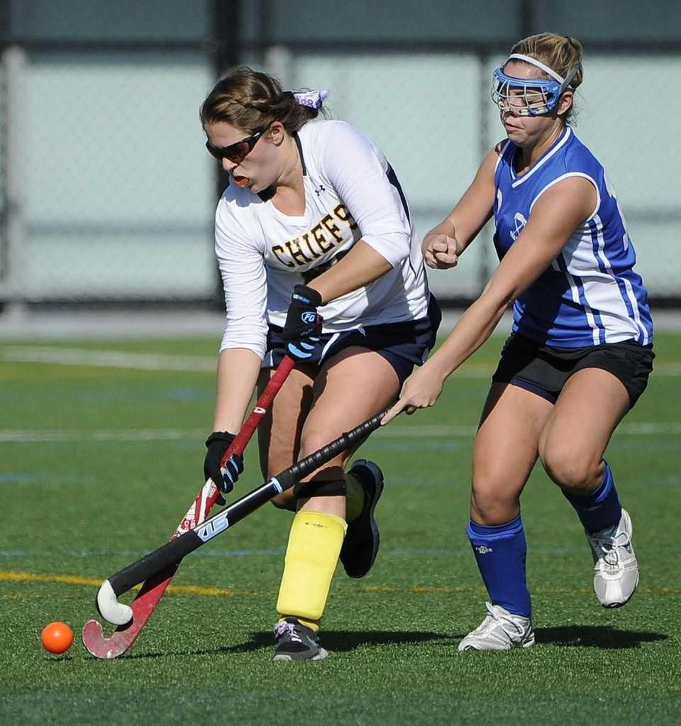 Massapequa's Elizabeth Doherty is pressured by Port Washington's
