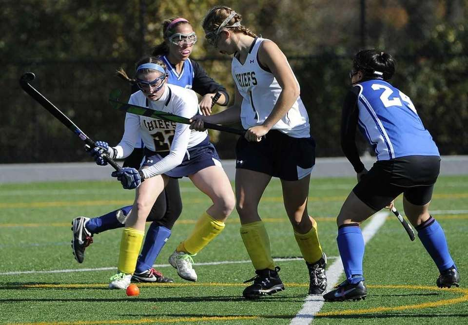 Massapequa's Kelsey O'Brien, left, shoots against Port Washington