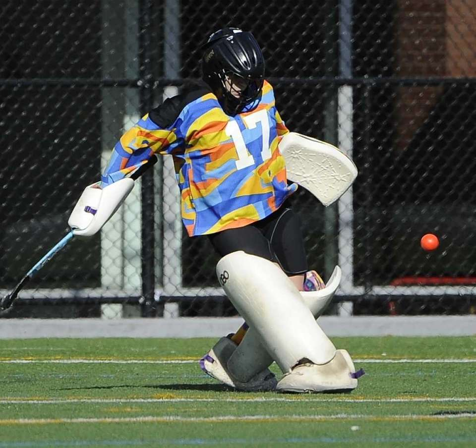 Massapequa goalkeeper Jacqueline Harrison makes a kick save
