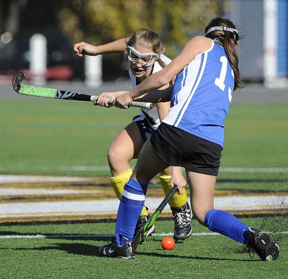 Massapequa's Lena Pollich, facing, defends against Port Washington's