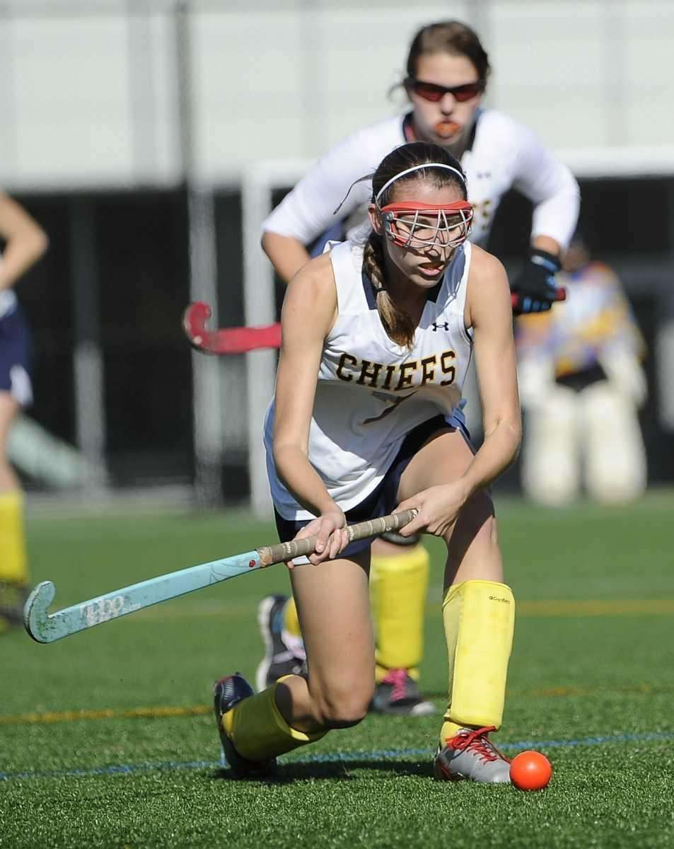 Massapequa's Kristin Yevoli plays the ball against Port