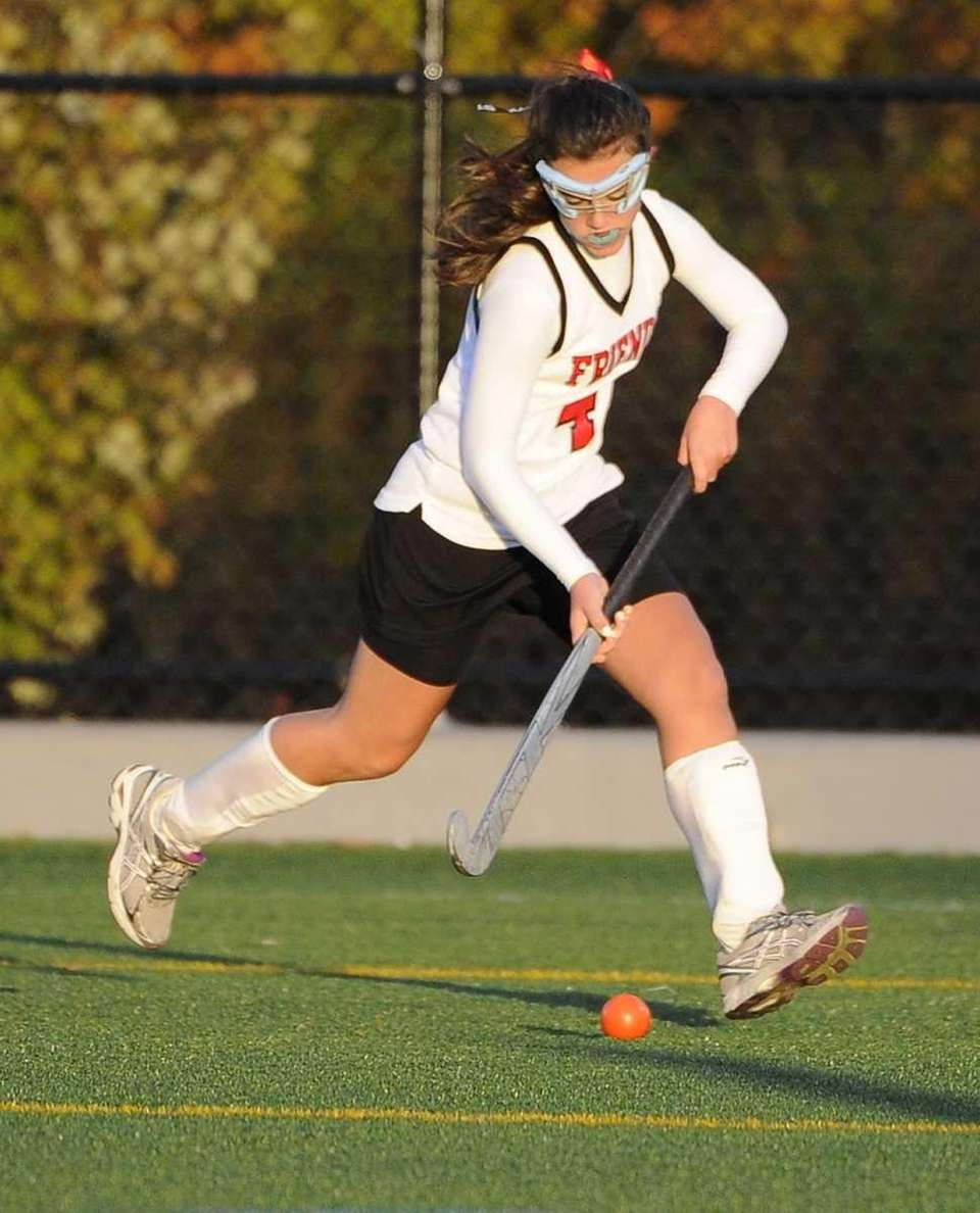 Friends Academy's Chloe Friedman moves the ball against