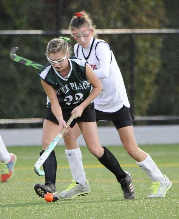 Carle Place's Taylor Ruscillo moves the ball against