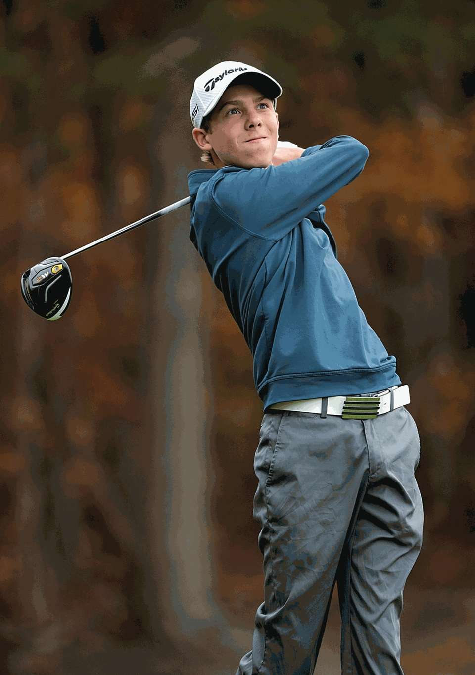 East Hampton's Turner Foster tees off at the