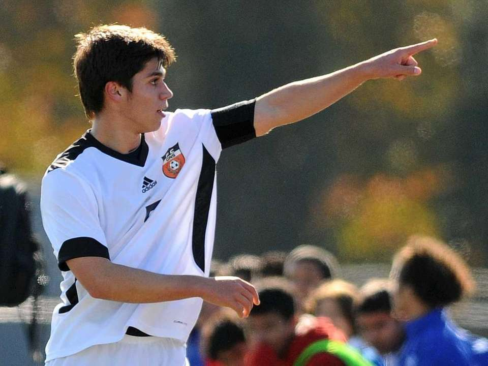 Great Neck South'sWilliam Rezin points to cheering fans