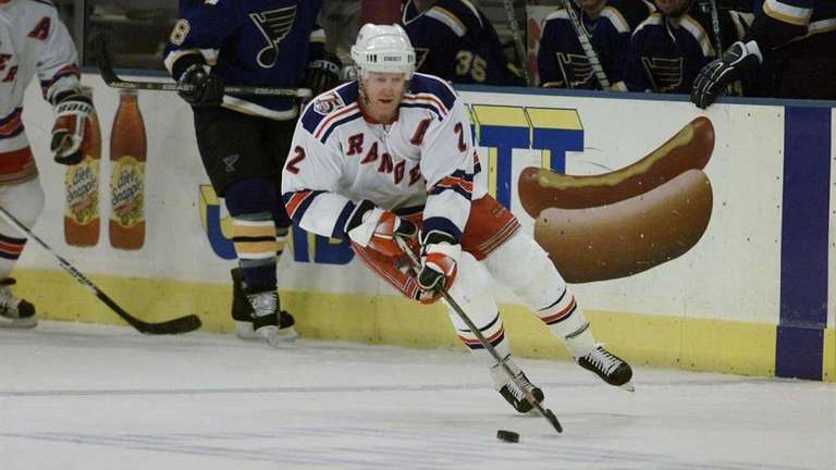 New York Rangers' Brian Leetch pushing the puck