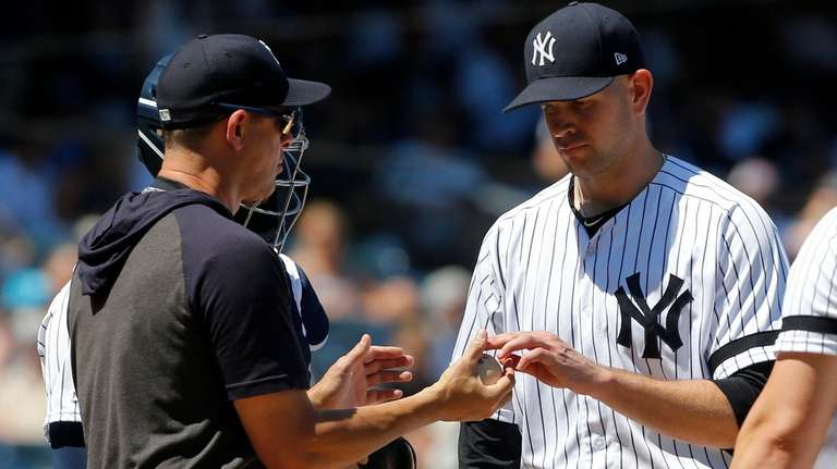 James Paxton #65 of the Yankees hands the