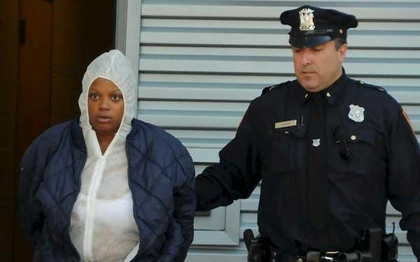 Cynthia Dean, 32, is escorted out of the