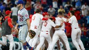 Mets first baseman Pete Alonso, left, walks off