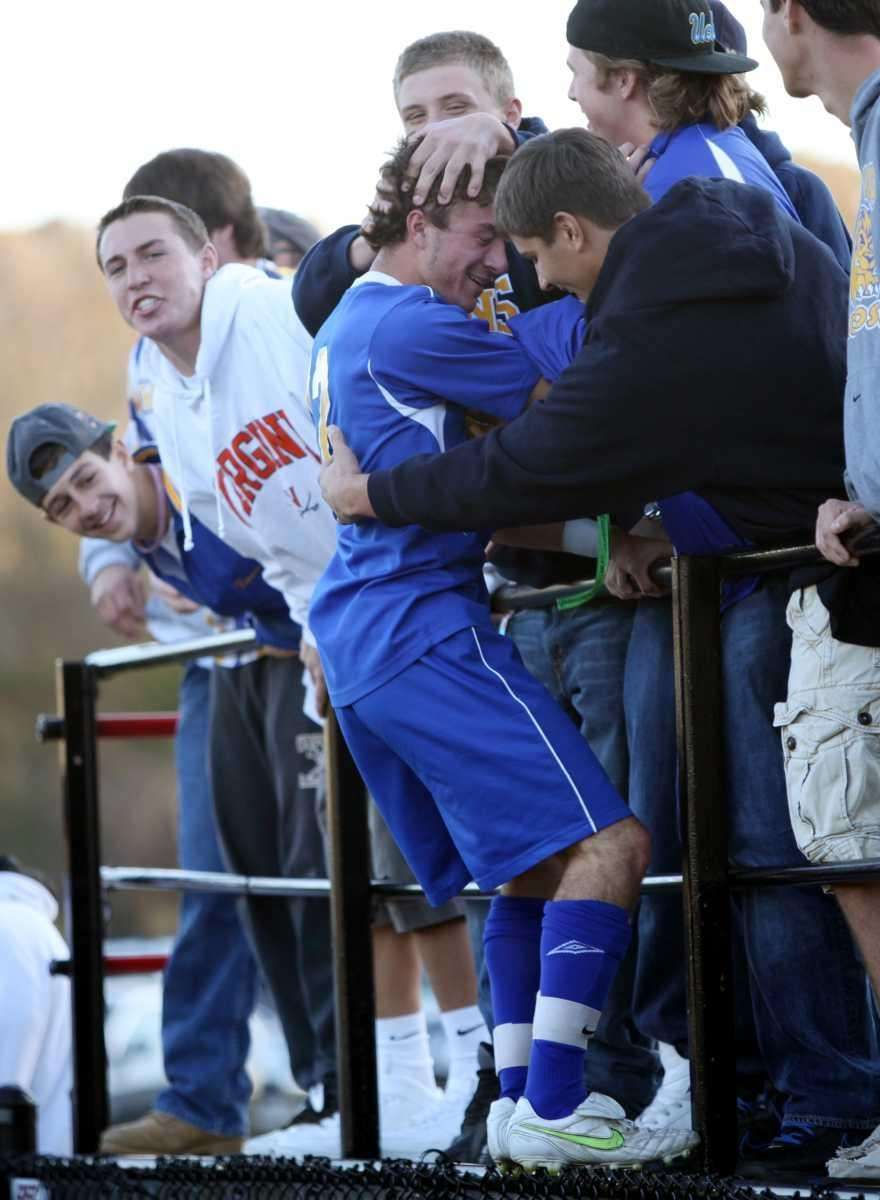 West Islip's Jack McKenna is greeted warmly by