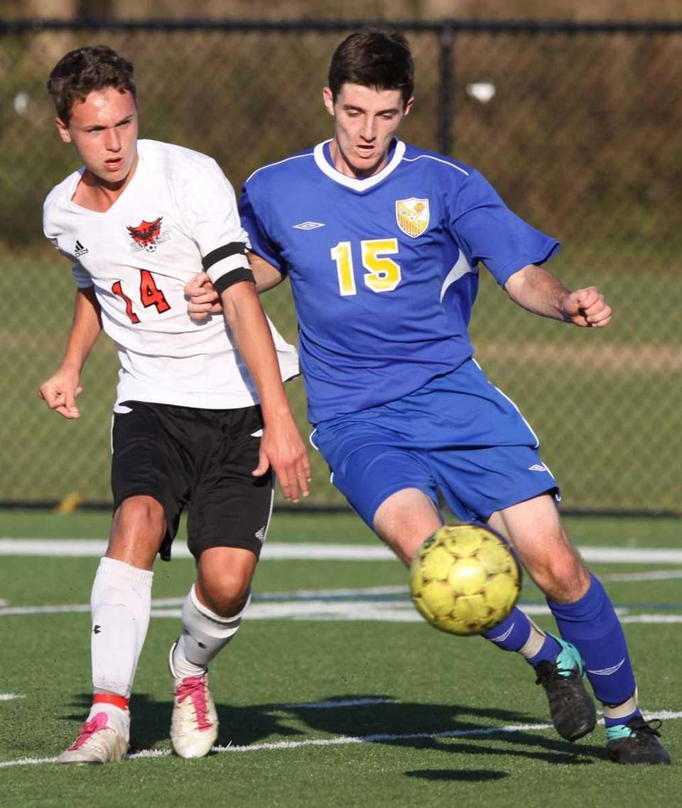 Half Hollow Hills East's Robby Reiser, left, and