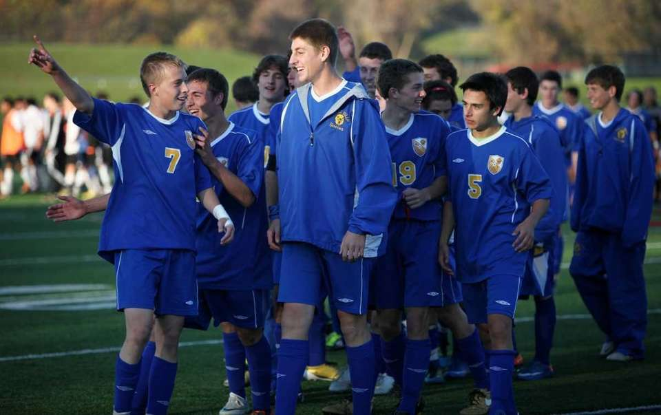 West Islip walks off the field after defeating