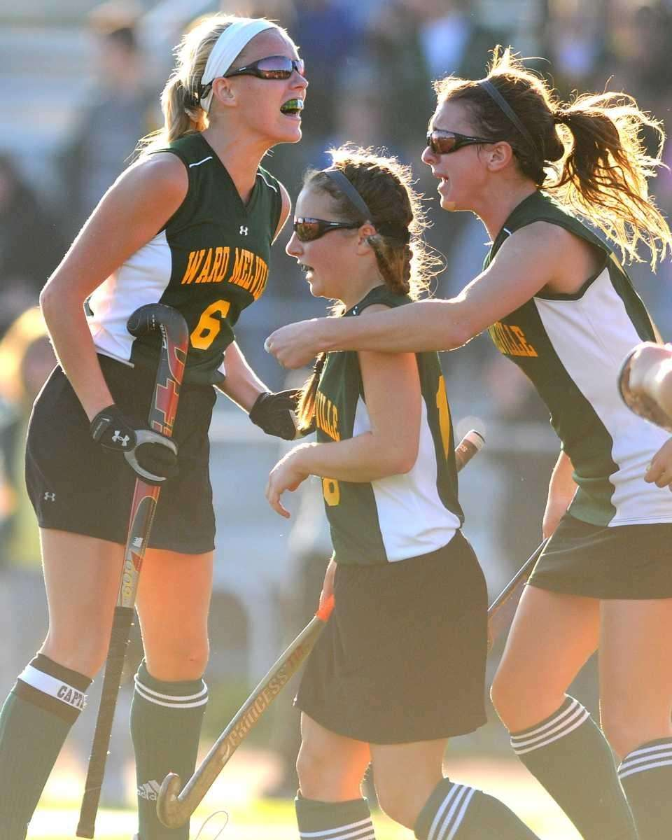 Ward Melville players, from left, #6 Kim Geiger,