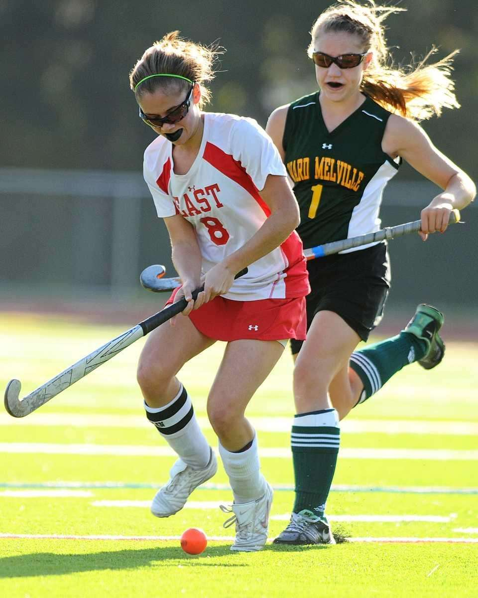 Smithtown East's Christina Fini, left, gets pressured by