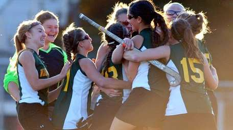 Ward Melville field hockey players react after their