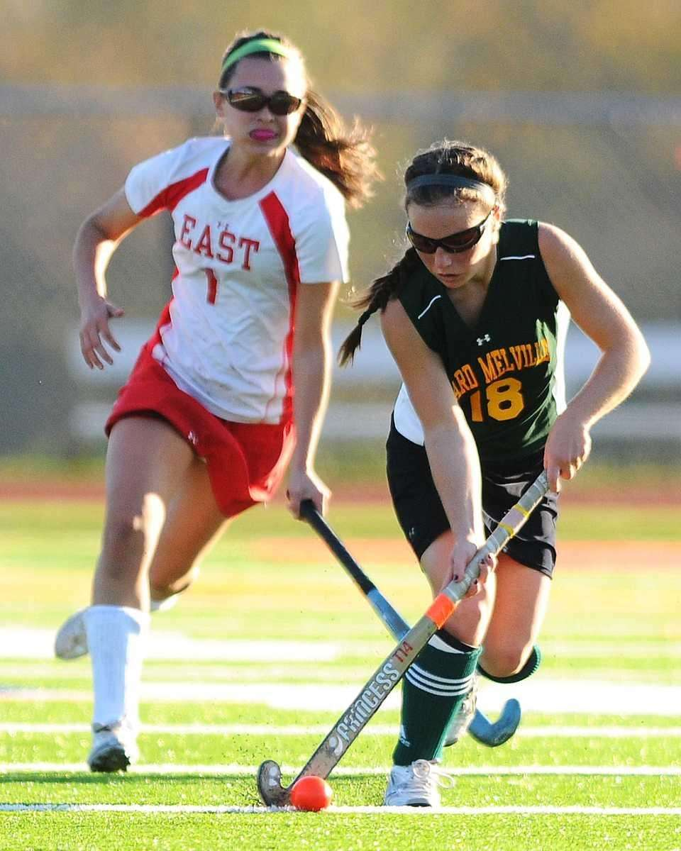 Ward Melville's Mary Brigid Coughlan, right, races downfield