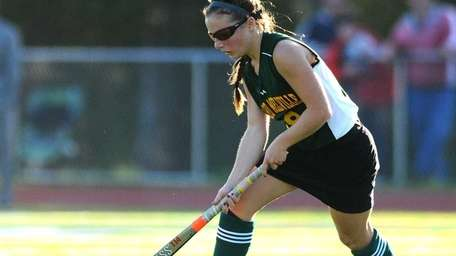 Ward Melville's Mary Brigid Coughlan cuts across the