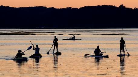 Kayakers and paddle boarders in the Stony Brook