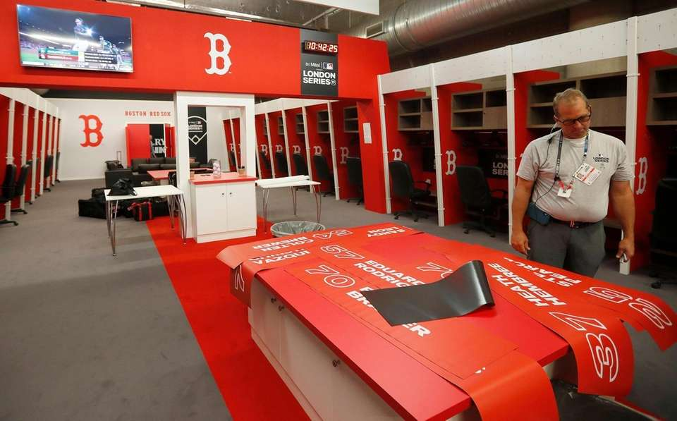 The Boston Red Sox clubhouse is prepared during