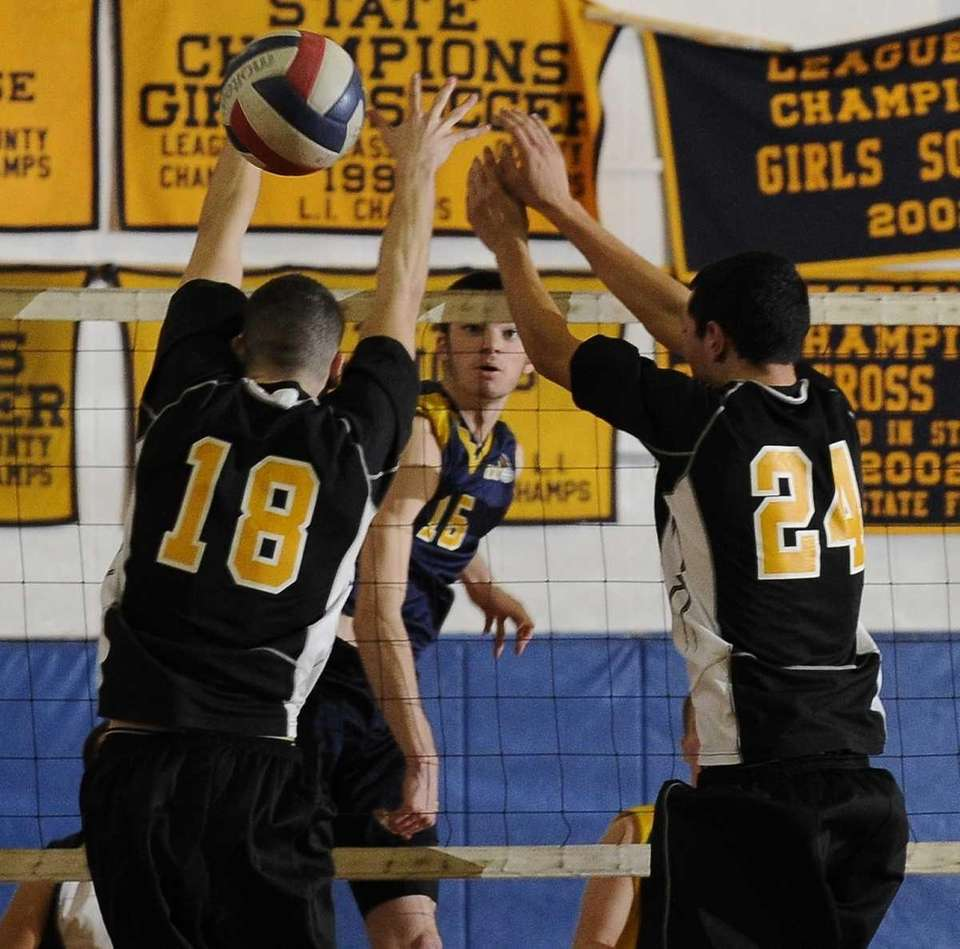 Northport's Brady Ambro hits a kill shot between