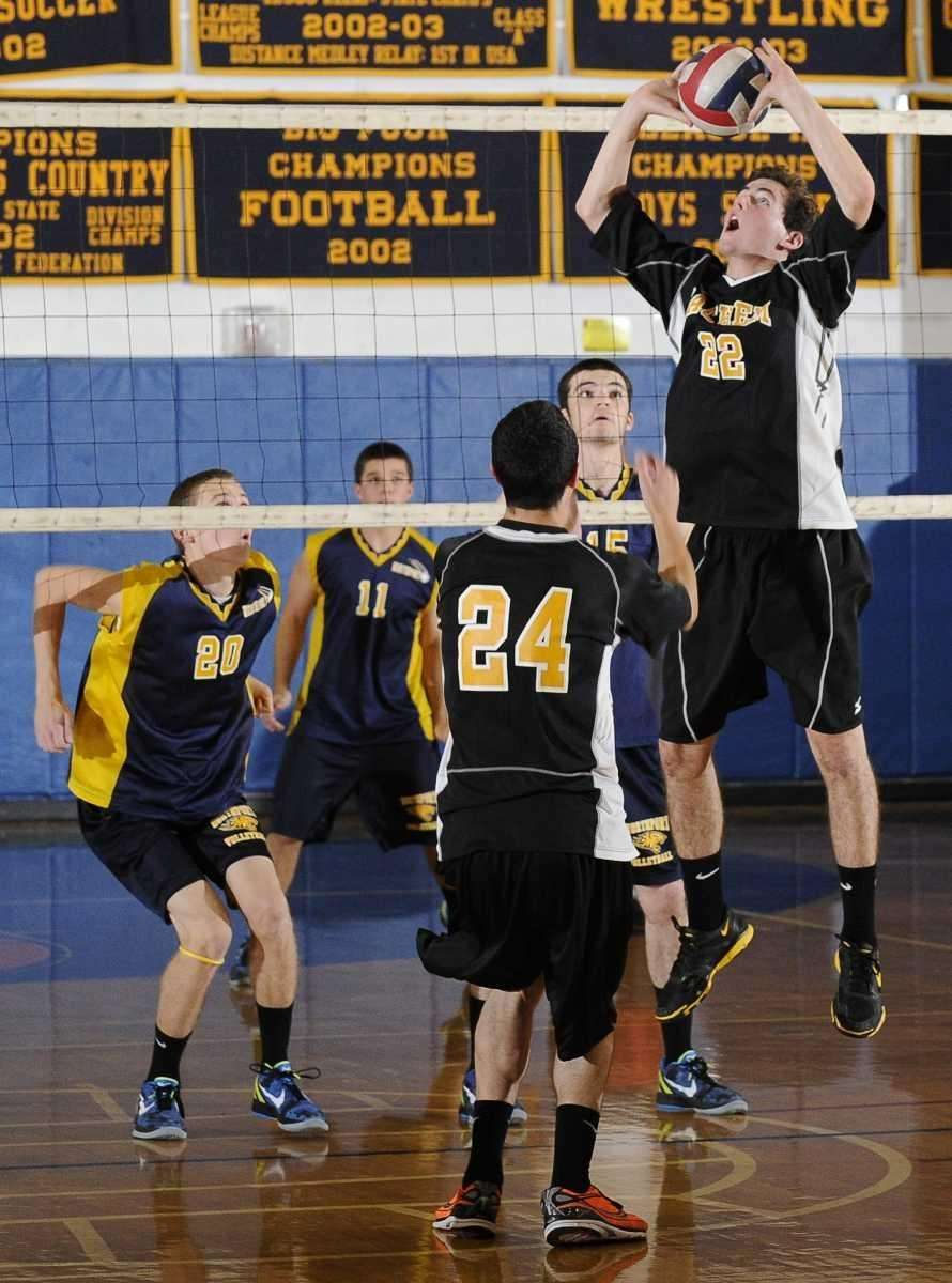 Sachem North's Chris Haun sets against Northport in