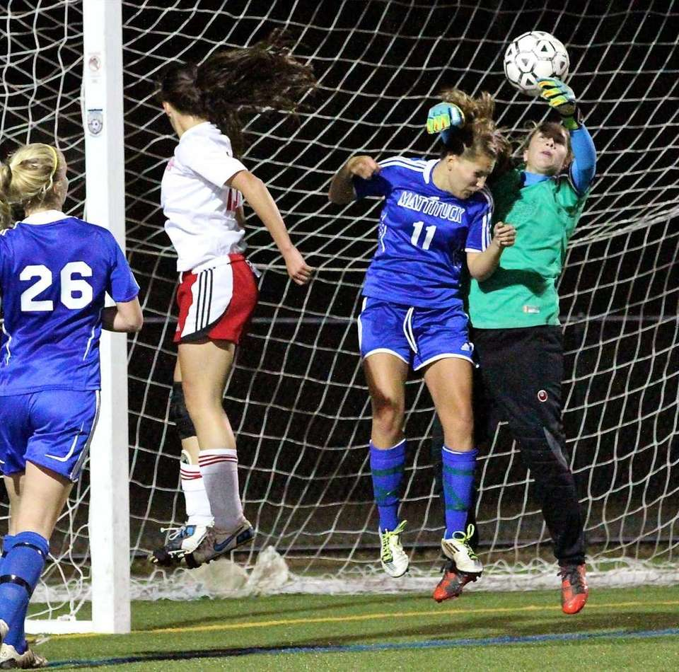Mattituck's Stephanie Reisenberg makes the save on the