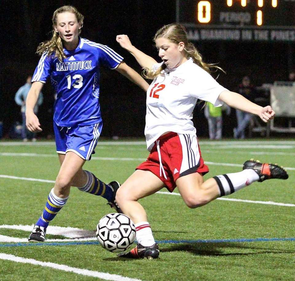 Center Moriches' Brianna Mascia kicks the ball out