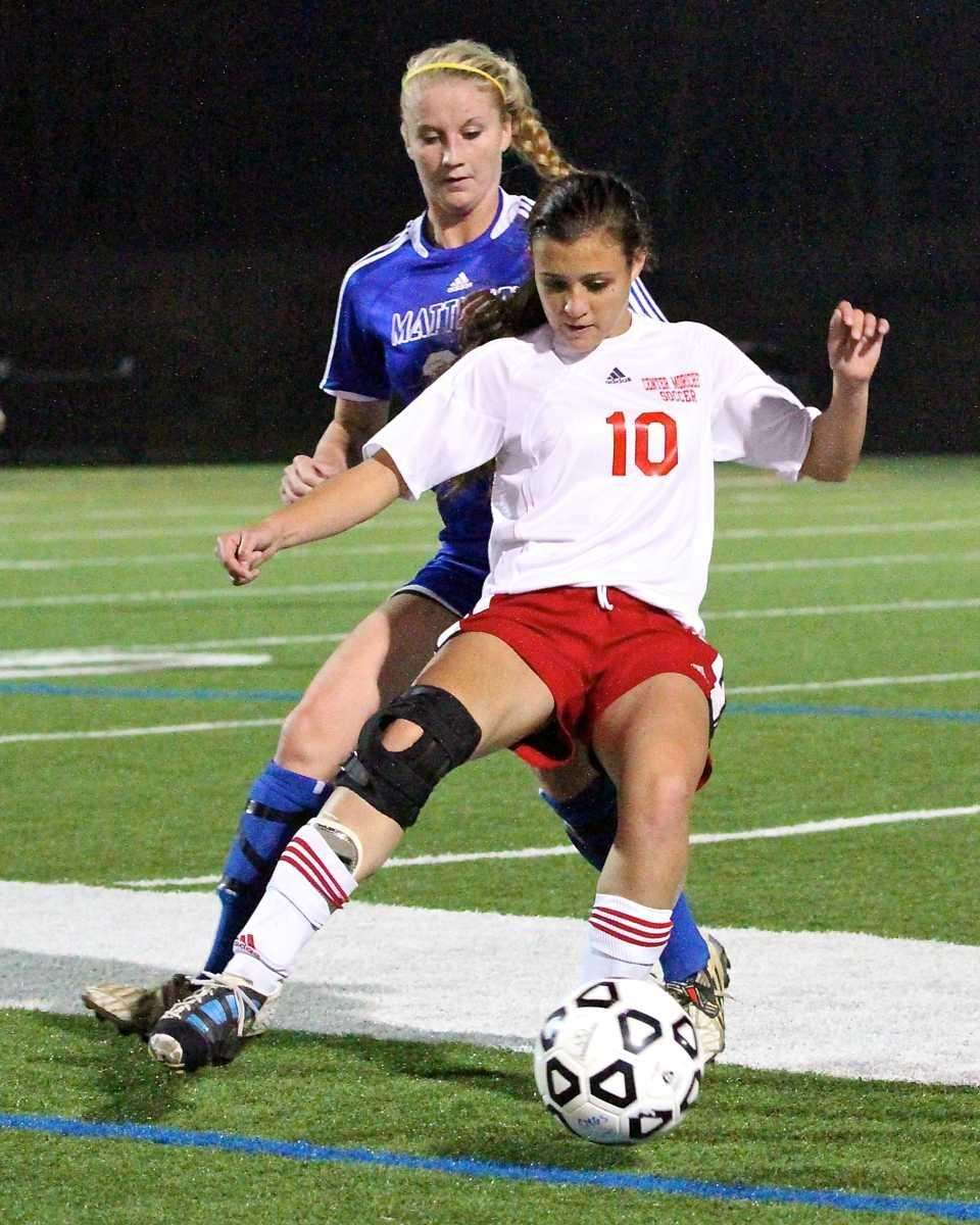 Center Moriches'Claire Brady shields the ball from Mattituck's