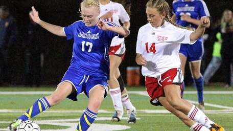 Mattituck's Anna Goeller, takes the ball into the
