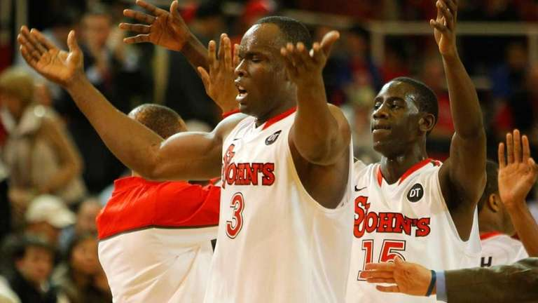 St. John's God'sgift Achiuwa and Sir'Dominic Pointer celebrate