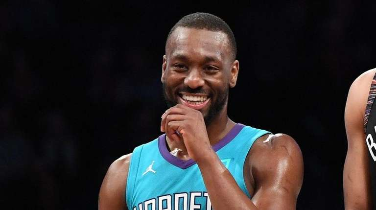 Hornets guard Kemba Walker and Nets guard Spencer