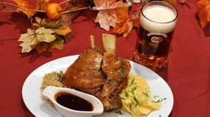 Crisp-skinned roasted Bavarian pork shank is served with