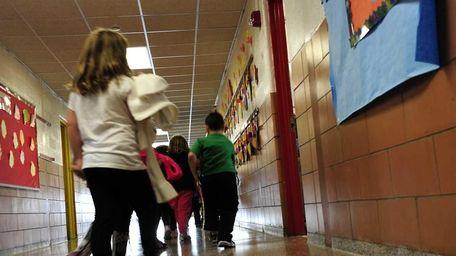 A first grade class returns to their classroom