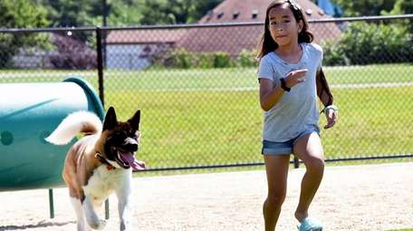 Sarah Rojas, 9, of Mineola, plays with her