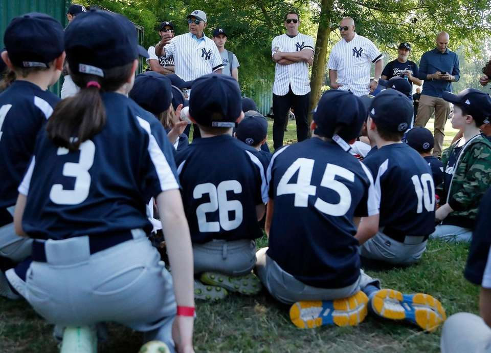 Yankees players speak to young fans during a