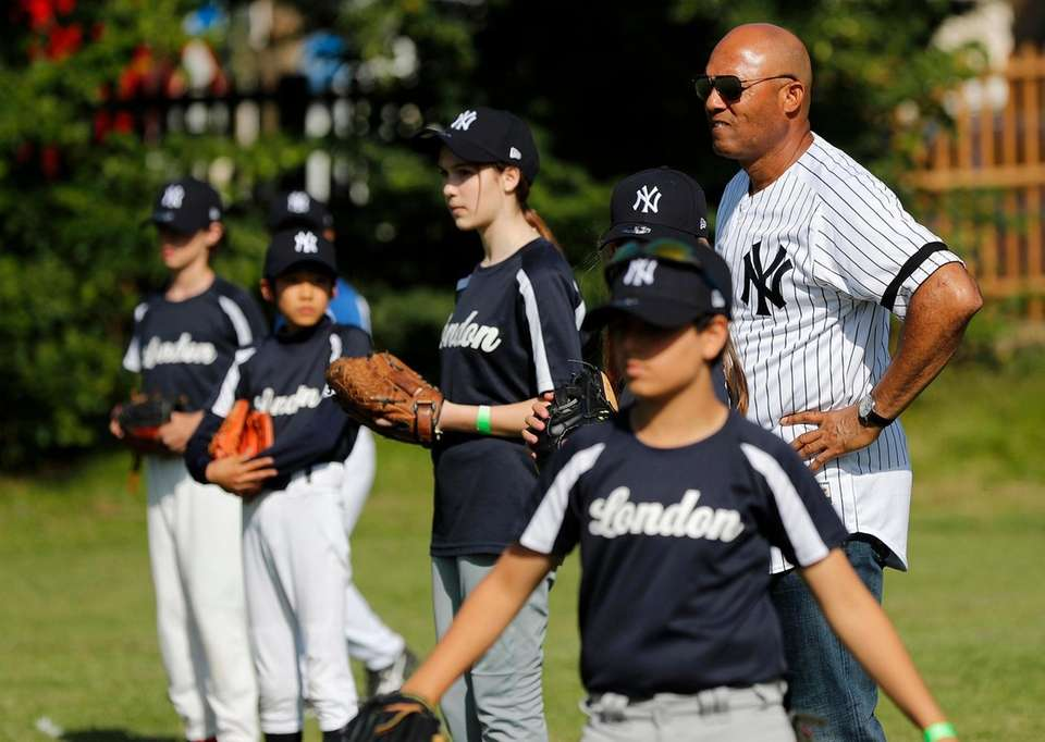 Yankees' Mariano Rivera watches players during a private