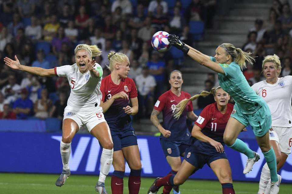 Norway's goalkeeper Ingrid Hjelmseth (R) makes a save