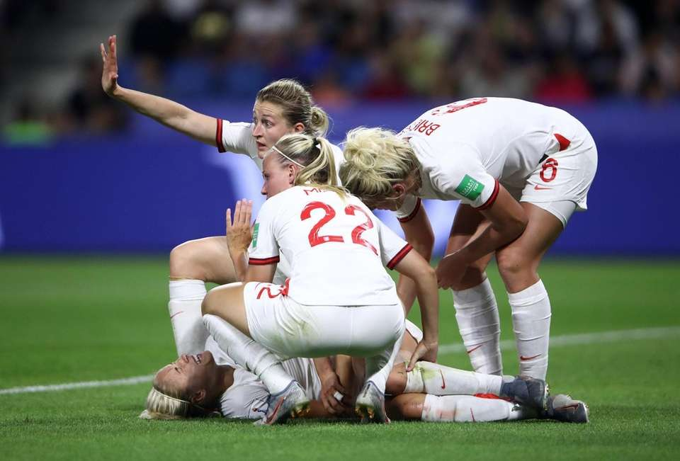Steph Houghton of England goes down injured during